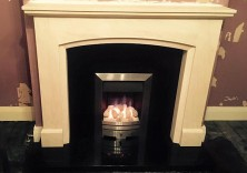 Bespoke Design in Rigel Marble with Black Granite Hearth and Back Panel and gas fire