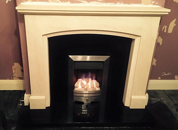 Bespoke Design in Rigel Marble with Black Granite Hearth and