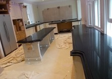 Black Starlight 60mm quartz worktops with a double ogee edge