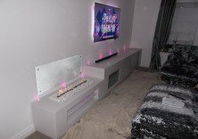 Bespoke media unit with gel burner and fibre optic lights in Polare White marble
